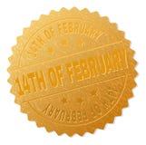 Guld 14TH AV den FEBRUARI medaljstämpeln Arkivbild