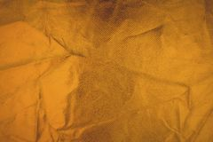 Guld- tråd på tyget Guld- textur blänker bakgrund Arkivbild