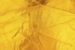 Guld- tråd på tyget Guld- textur blänker bakgrund Royaltyfria Foton