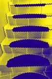 Guld- trappa upp Royaltyfri Bild