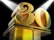 Guld- trettio på sockel betyder trettionde seger Arkivbild