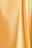 guld- tyg Arkivfoto