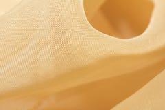 Guld- tyg som en bakgrund Makro Fotografering för Bildbyråer