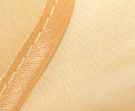 Guld- tyg som en bakgrund Makro Royaltyfri Fotografi