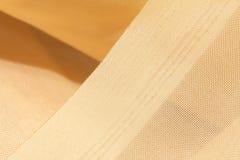 Guld- tyg som en bakgrund Makro Royaltyfri Bild