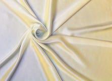 Guld- tygtexturbakgrund, krabbt tyg Fotografering för Bildbyråer