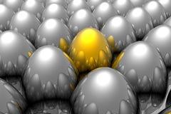 guld- unikt för ägg Arkivbild