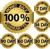 Guld- uppsättning för pengarbaksidagaranti Arkivfoton