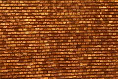 guld- vägg för tegelsten Arkivbild