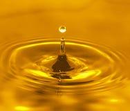 guld- vatten Arkivfoto