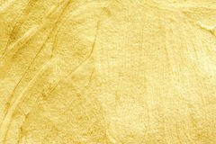 Guld- vattenfärg texturerad bakgrund Abstrakt blänka för guld Arkivbilder