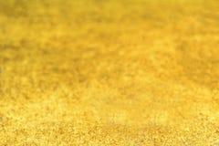 Guld- vattenfärg texturerad bakgrund Abstrakt blänka för guld Fotografering för Bildbyråer