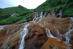 Guld- vattenfall Fotografering för Bildbyråer