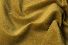 Guld- velourtygbakgrund, sammet, mohair, kaschmireffekt Royaltyfria Bilder