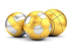 Guld- volleyboll, basket och soccerball Arkivfoton
