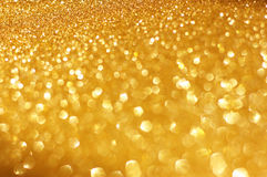 Guld- vår eller sommarbakgrund. Elegant abstrakt bakgrund med defocused ljus för bokeh Arkivfoton