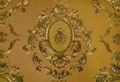 guld- wallpaper Arkivfoto