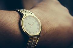 guld- watch Fotografering för Bildbyråer