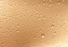 guld- waterdrops Arkivfoton