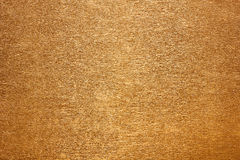 Guldpapper med en fin textur Arkivfoton