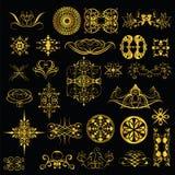Guldprydnader på en svart bakgrund set1 Arkivfoto