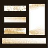 Guldstoft på vit bakgrund Guld blänker bakgrund Arkivfoto
