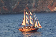 Gulet sailing at sunset near Santorini Island Stock Photo