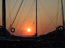 Gulet at sunset. Sunset from a Turkish gulet mooring in front of Demre island, Turkey Stock Photos