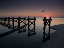 Gulf Coast beach with broken pier after Hurricane Stock Image