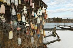 Free Gulf Coast Of The Atlantic Ocean. Fishing Pier. Old Barn With Fishing Nets And Old Floats And Buoys. Royalty Free Stock Photos - 169964818