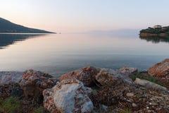 Gulf of Corinth Bay in Pink Dawn Light, Greece stock image