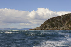 Gulf of Corryvreckan. View from the Gulf of Corryvreckan between the islands of Scarba and Jura, with the tip of Scarba opposite and Mull on the horizon, showing Royalty Free Stock Image