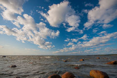 Gulf of finland. Big stones in the sea, gulf of finland landscape. Dark blue sky with clouds Royalty Free Stock Photography