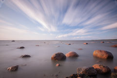 Gulf of finland. Big stones in the sea, gulf of finland long exposure landscape. 4 minutes of exposure Stock Images