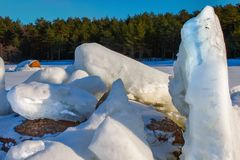 The Gulf of Finland. Iced granite boulders of the glacial period royalty free stock photo