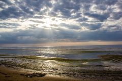 The Gulf of Finland before sunset, the rays of the sun pass through the overcast sky royalty free stock photography