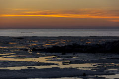 Gulf of Finland, the water is covered with melting ice, the sky Royalty Free Stock Images