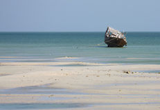 Gulf Fishing Boat (Dhow). Dhow at low tide in the Arabian Gulf Royalty Free Stock Photo