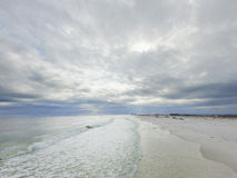 Gulf of Mexico and Beach in Pensacola. Cloudy and Rainy sky in background. Gulf of Mexico and Beach in Pensacola Royalty Free Stock Image