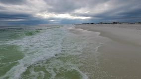 Gulf of Mexico and Beach in Pensacola, Florida. Cloudy evening sky.  stock footage