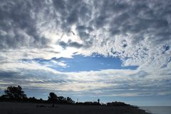 Storm clouds begin to clear over the Gulf of Mexico after the sunrise. Stunning sky shortly after the sunrise with clouds and ocean water in Florida on the Gulf Royalty Free Stock Photo