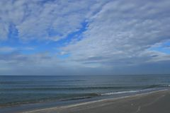 Gulf of Mexico beach and clearing clouds after sunrise Stock Images