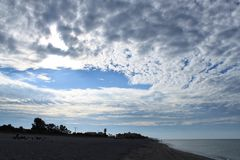 Cumulonimbus clouds being to part after sunrise on the Gulf of Mexico  Royalty Free Stock Photography
