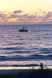 Gulf of Mexico Fisherman and Trawler at Sunset Royalty Free Stock Photo