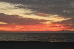 Gulf of Mexico sunset burns the sky with its brilliant colors Stock Photos
