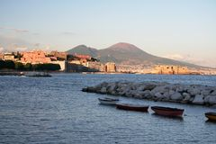 Gulf of Naples at sunset. A romantic view of the gulf of Naples (Italy) with the mount Vesuvius on the back, Egg's castle and fishermans'boat Stock Image