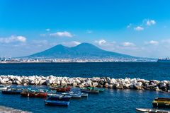 Gulf of Naples with wooden fishing boats and the Vesuvio at the background royalty free stock photography
