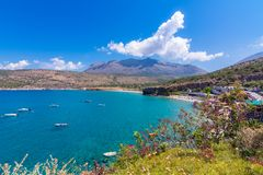 The gulf outside of the amazing caves of Dirou with fishing boats and turquoise waters, Peloponnese. The gulf outside of the amazing caves of Dirou with fishing royalty free stock photography