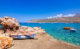 The gulf outside of the amazing caves of Dirou with fishing boats and turquoise waters, Peloponnese. The gulf outside of the amazing caves of Dirou with fishing royalty free stock image