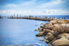 Gulf at pier with sea birds in the distance. In summer day stock images